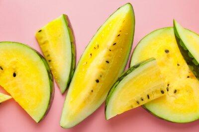 Bild Cut yellow watermelon on color background