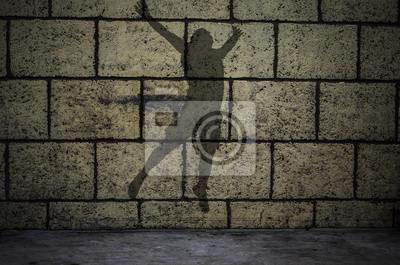 Der Jumper Silhouette an der Wand