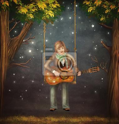 Der Junge sitzt auf der Schaukel im Wald und spielt auf der Gitarre