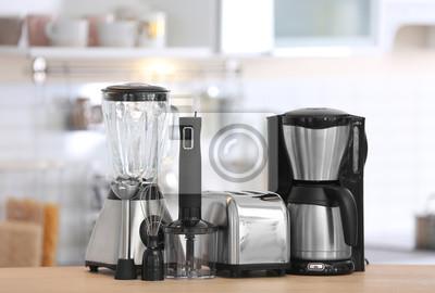 Bild Different modern kitchen appliances on table indoors. Interior element