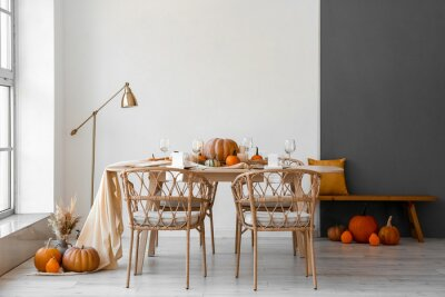 Bild Dining table with pumpkins in interior of room