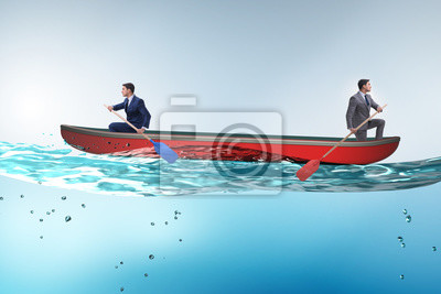 Bild Disagreement concept with businessmen rowing in different direct