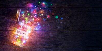 Bild Dreams Concept - Colorful Lights In Open Jar
