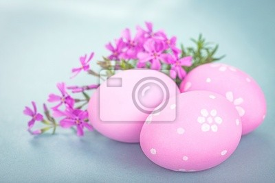 Easter eggs and crocuses isolated on white background.