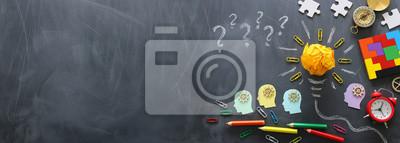 Bild Education concept image. Creative idea and innovation. Crumpled paper as light bulb metaphor over blackboard