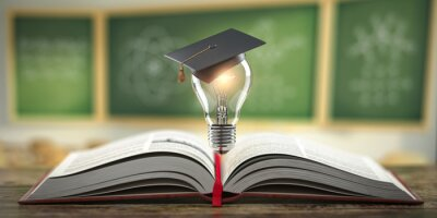 Bild Education, learning on school and university or idea concept. Open book with light bulb and graduation cap on classroom blackboard background.