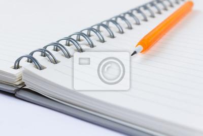 Bild ein Bleistift und ein Buch