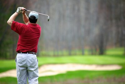 Bild Ein Mann genießen ein Spiel des Golfs