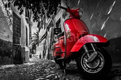 Bild Ein roter Vespa-Roller parkte auf einer gepflasterten Straße