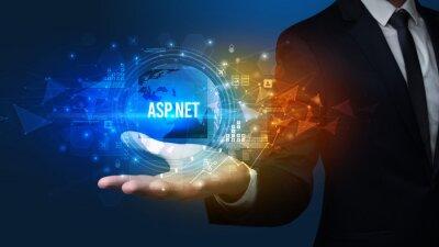 Elegant hand holding ASP.NET inscription, digital technology concept
