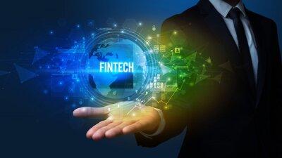 Elegant hand holding FINTECH inscription, digital technology concept
