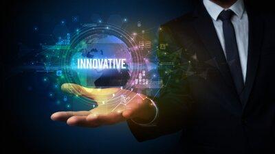 Elegant hand holding INNOVATIVE inscription, digital technology concept