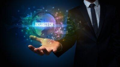 Elegant hand holding INSURTECH inscription, digital technology concept