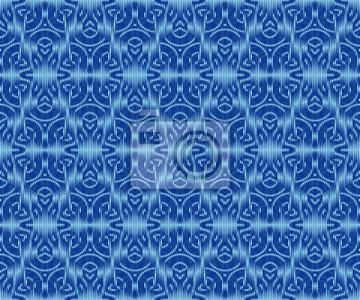 Elegant patterned textile texture indigo dyed ikat seamless pattern.