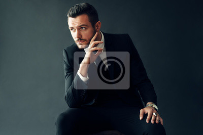 Bild Elegant young man portrait on black background