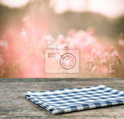 Bild Empty wooden and tablecloth with nature background.