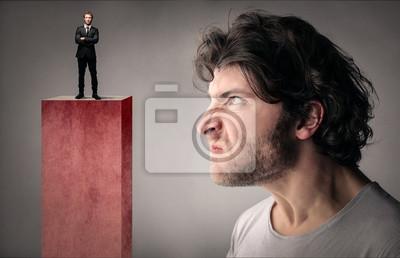 Bild Envious man looking at a manager