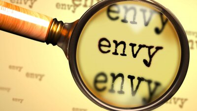 Bild Envy - abstract concept and a magnifying glass enlarging English word Envy to symbolize studying, examining or searching for an explanation and answers related to the idea of Envy, 3d illustration