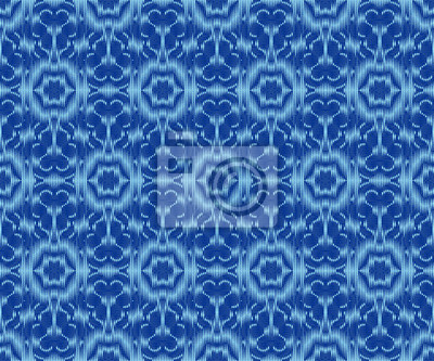 Ethnic patterned fabric indigo dyed ikat seamless pattern.