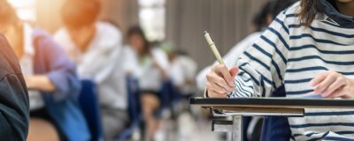 Bild Exam at school with student's taking educational admission test in class, thinking hard, writing answer in university classroom, education and world literacy day concept