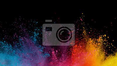 Bild Explosion of colored powder on black background