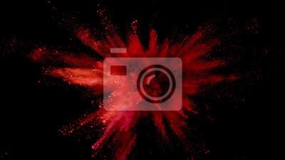 Bild Explosion of coloured powder on black background.