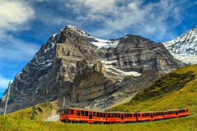 Bild Famous electric red tourist train coming down from the Jungfraujoch station(top of Europe) in Kleine Scheidegg,Bernese Oberland,Switzerland,Europe