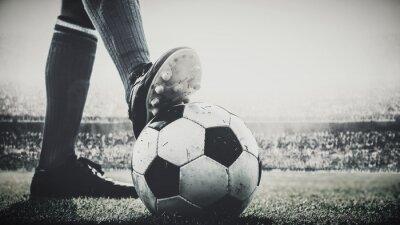 Bild feet of soccer player tread on soccer ball for kick-off in the stadium black and white