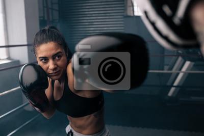 Bild Female boxer training inside a boxing ring