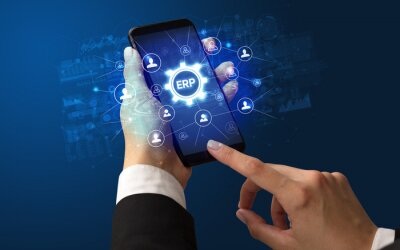 Female hand holding smartphone with ERP abbreviation, modern technology concept