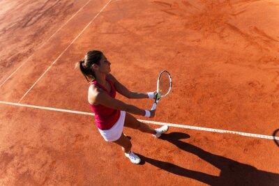 Bild Female tennis player serving a tennis ball