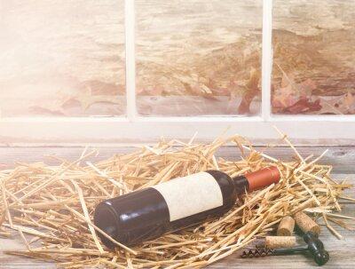 Bild Fensterleuchte auf Weinflasche ruht in Stroh