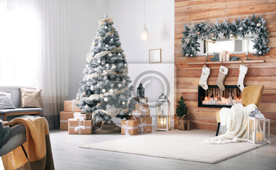 Bild Festive interior with decorated Christmas tree and fireplace