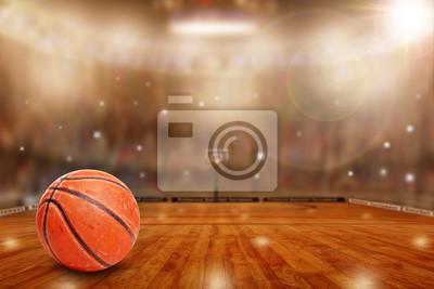 Fiktive Basketballarena mit Ball auf Gericht und Kopienraum. Kamera Blitze und Lichteffekte besondere Lichteffekte auf defokussierten Hintergrund.