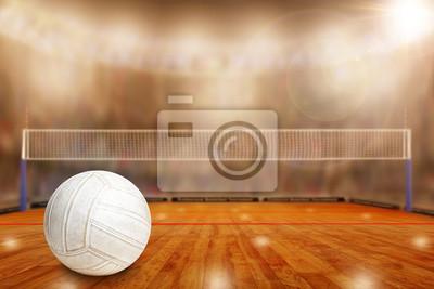 Fiktive Volleyballarena mit Ball auf Gericht und Kopie Raum. Fokus auf Vordergrund mit spezieller Beleuchtung und Blendenfleckeffekt auf Hintergrund.