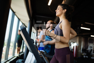 Bild Fit group of people exercising on a treadmill in gym
