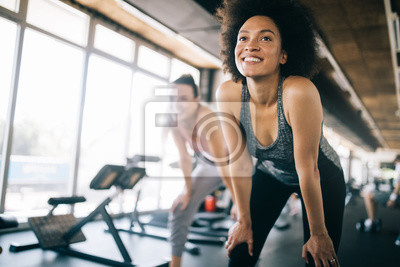 Bild Fit sportswoman exercising and training at fitness club
