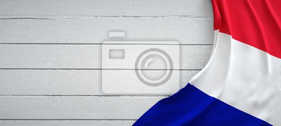 Bild Flag of France, on top of white wood. Wrinkled fabric.