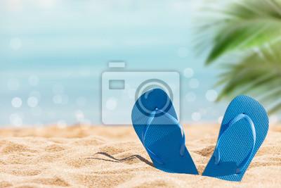 Bild flip flops on the sunny tropical beach with palm tree