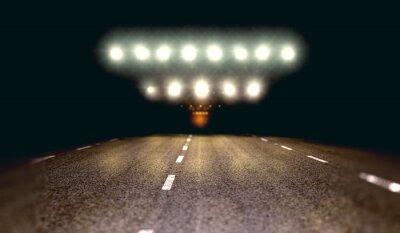 Fondo de carretera y asfalto en la noche con luces de focos.