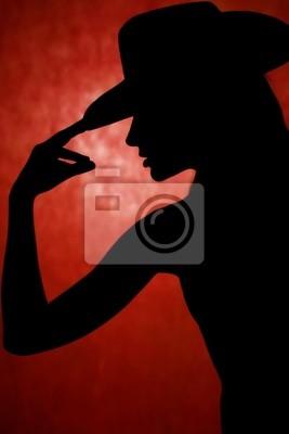 Frau tanzen, Silhouette vor orrange Hintergrund