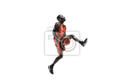 Bild Full length portrait of a basketball player with a ball isolated on white studio background. advertising concept. Fit african anerican athlete jumping with ball. Motion, activity, movement concepts.
