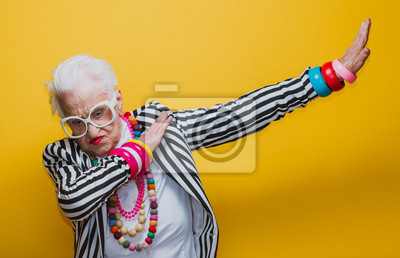 Bild Funny grandmother portraits. Senior old woman dressing elegant for a special event. granny fashion model on colored backgrounds