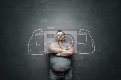 Bild Funny sports nerd with huge muscle arms drawn on the gray background with copy space