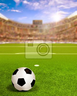 Fußball-Arena mit Sonnenaufgang und Ball auf dem Feld