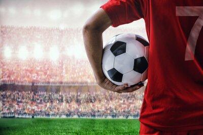 Fußball-Fußball-Spieler im roten Team-Konzept Betrieb Fußball im Stadion