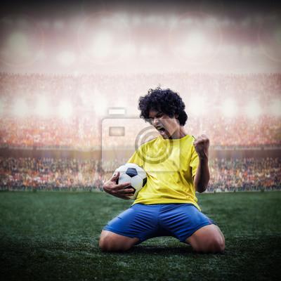 Fußball oder Fußball-Spieler feiert Ziel