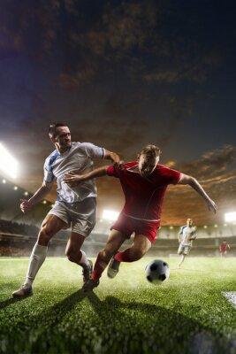 Bild Fußball-Spieler in Aktion auf Sonnenuntergang Stadion Hintergrund