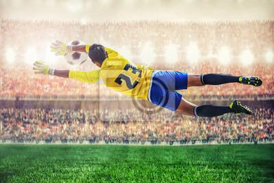 Fußball-Torhüter fliegen, um den Ball im Stadion fängt