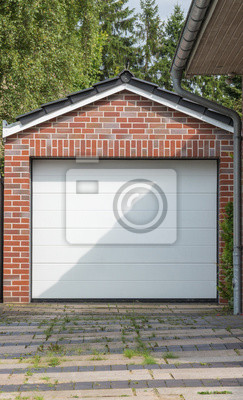 Gemauerte Garage gemauerte garage mit weißem tor leinwandbilder • bilder carport